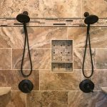 Photo of a tile show with dual shower heads.