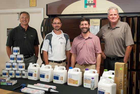 Photo of: Mark Raymond, Bona Adhesive Specialist; Michael Arnold, President of Arnold Flooring; Graham Blue, Bona US Senior Territory Manager; Dave Darche, Bona National Market Manager - Adhesives/A&D.